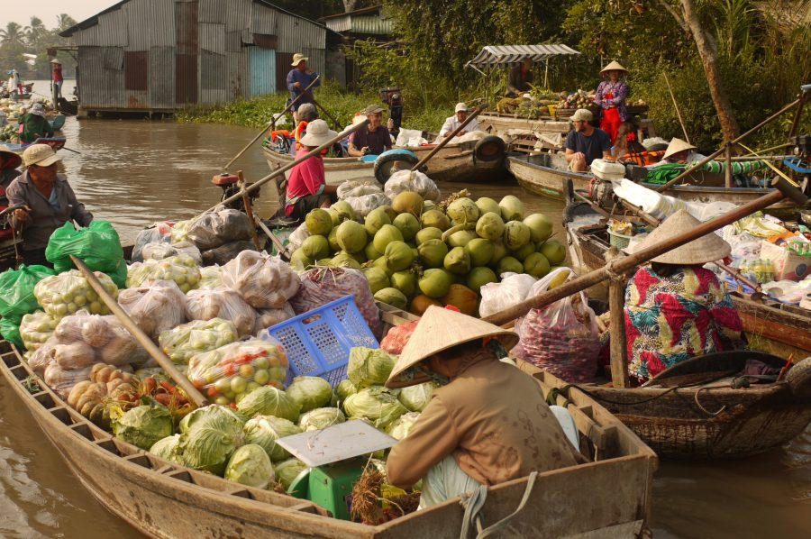 Loaded boats at the floating markets in Can Tho, Vietnam