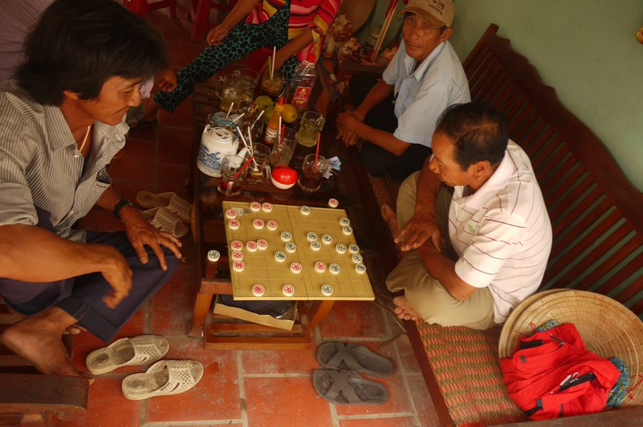 Men playing checkers