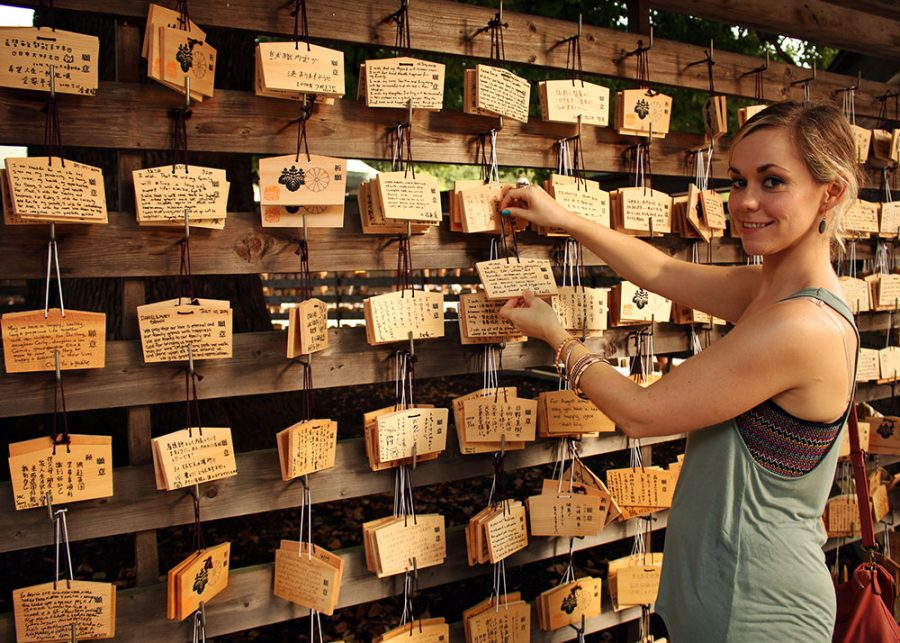 Noelle adding our wishes to the bunch; Meji Shrine, Tokyo