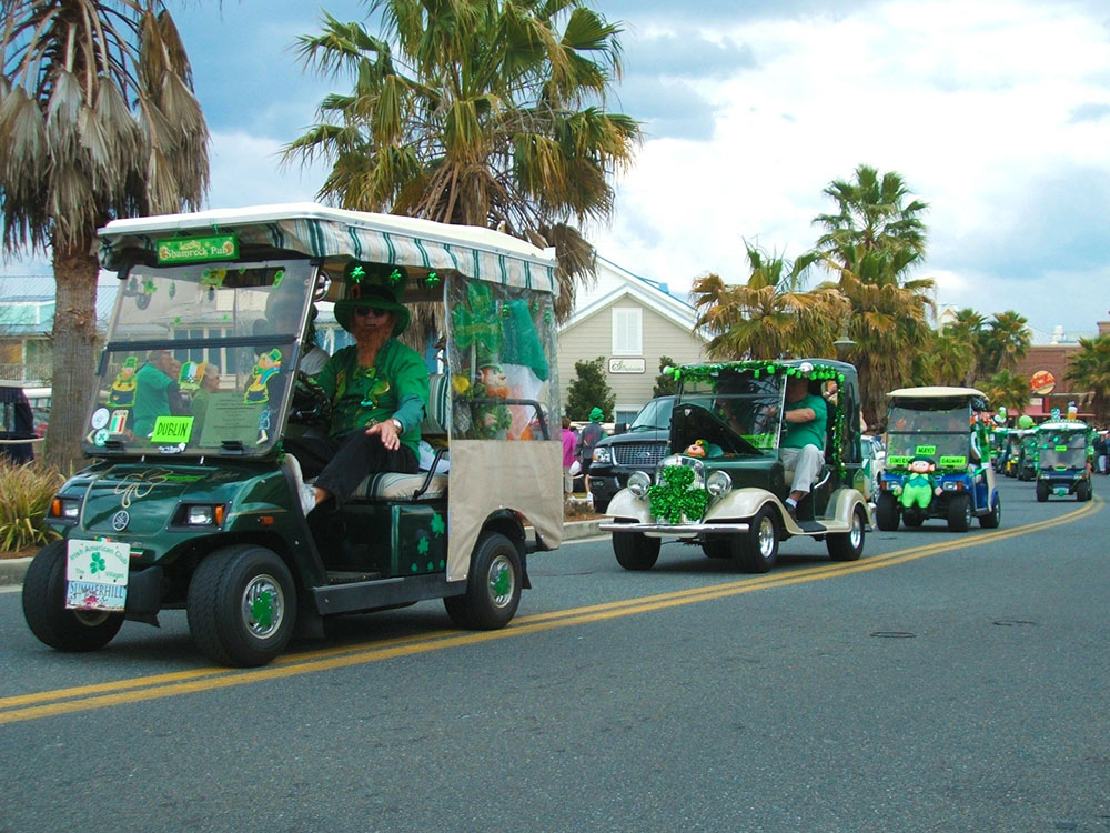 Retirees on green golf carts for St. Patrick's Day in Florida