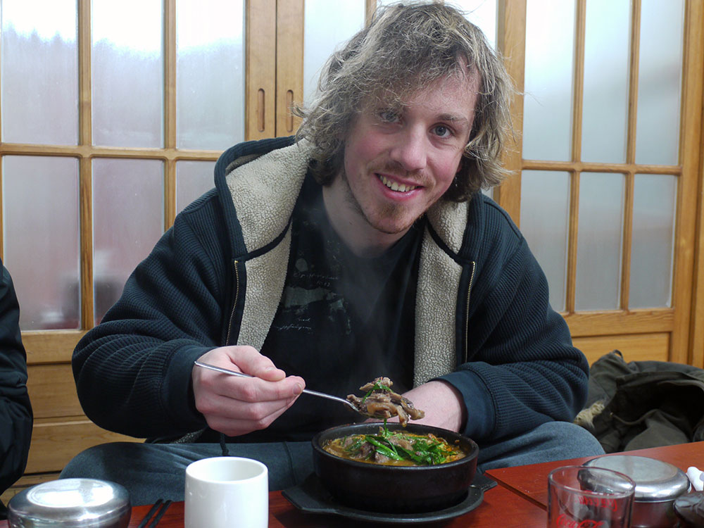 Brian eating Boshintang (Dog Meat Soup in South Korea)