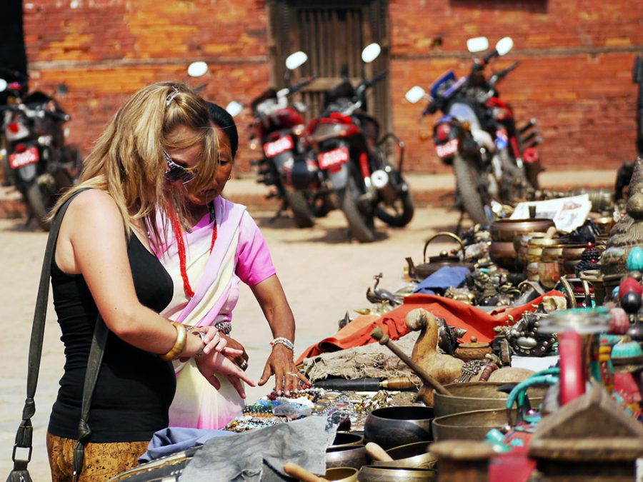 Noelle bargaining for trinkets in Nepal