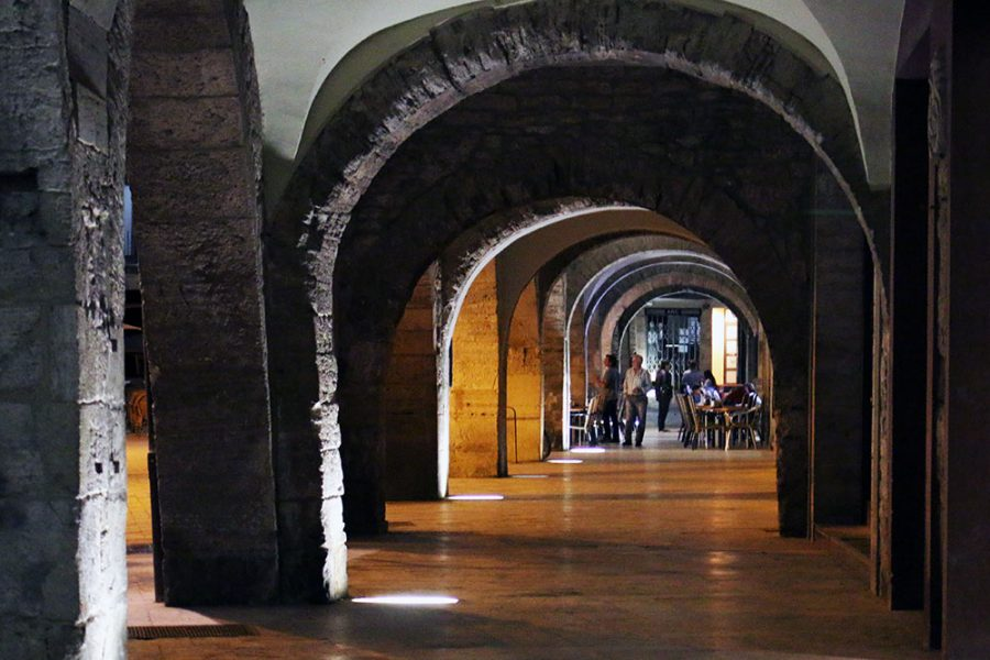 Stone archways surround Banyoles main square
