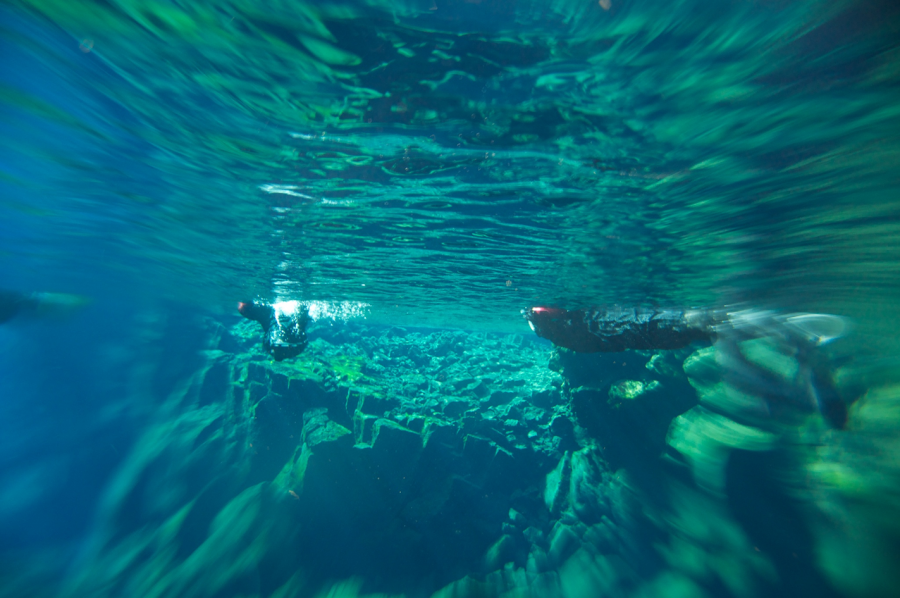 Scuba dive or snorkel between the tectonic plates at Silfra, Icleand
