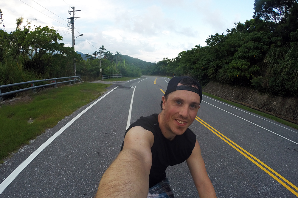 Brian taking a selfie while cycling in Taiwan