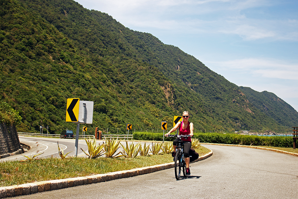 Noelle cycling in Taiwan on Highway 11, cycling Taiwan's east coast