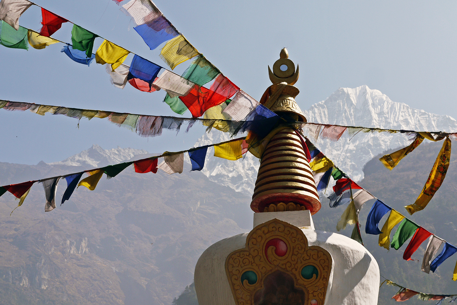 Colourful Nepali prayer flags with the Himalayas in the background