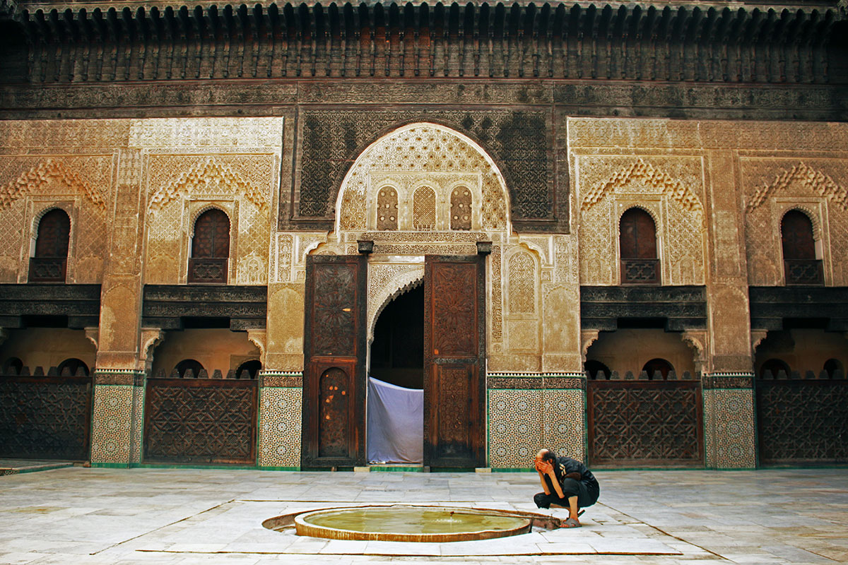 A man prepares for prayer at the Mosque of al-Qarawiyyin