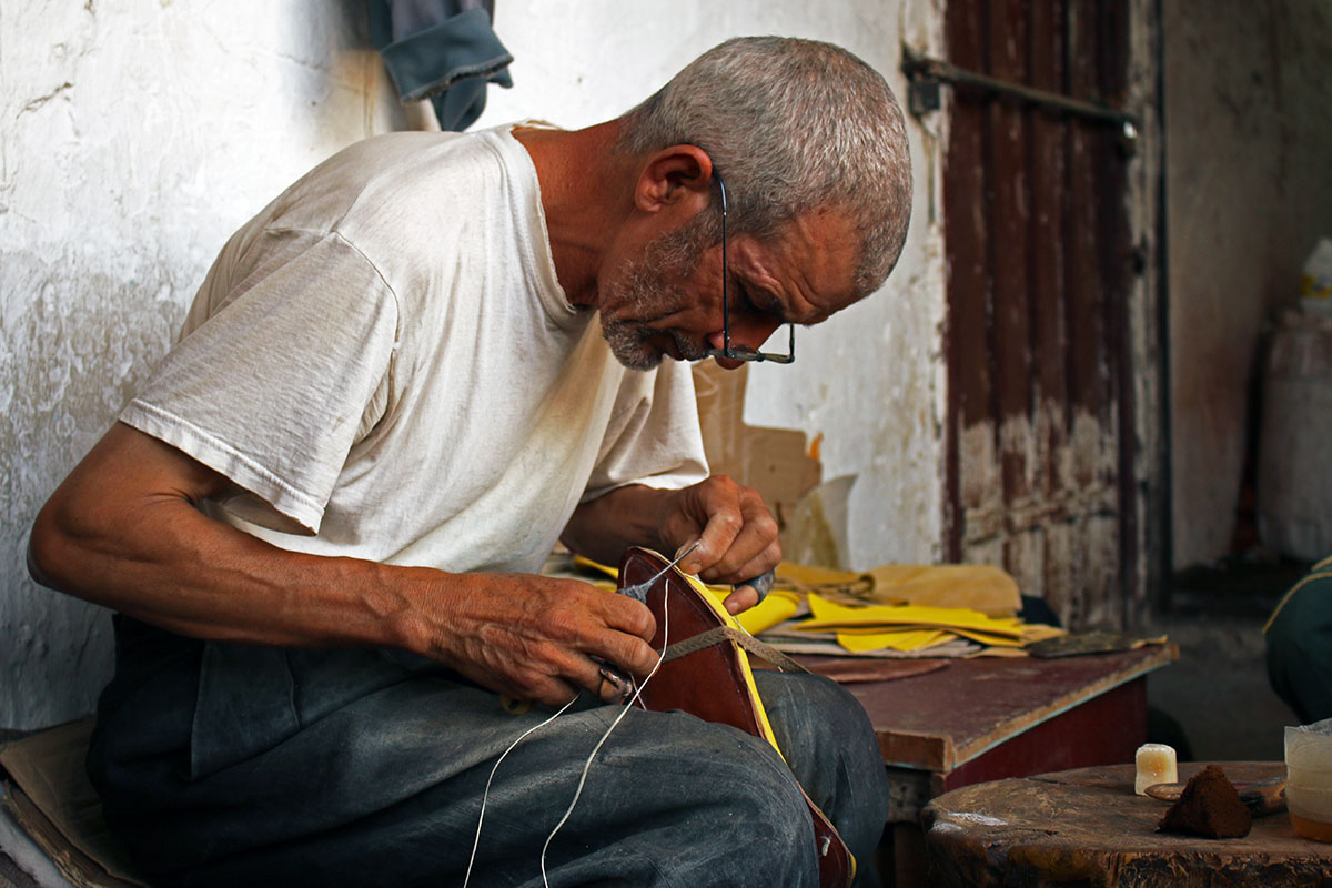 Stitching shoes by hand
