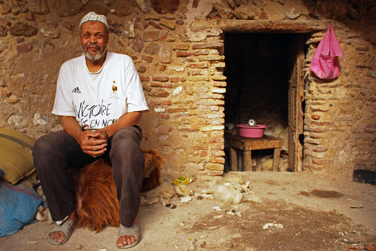 Berber man sitting outside his home in the tanneries
