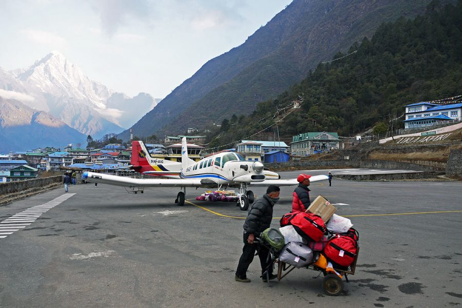 Porters moving bags at Lukla Airport