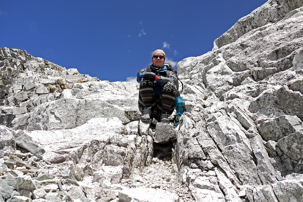 Noelle taking a breather while walking the Everest Base Camp Trek independently