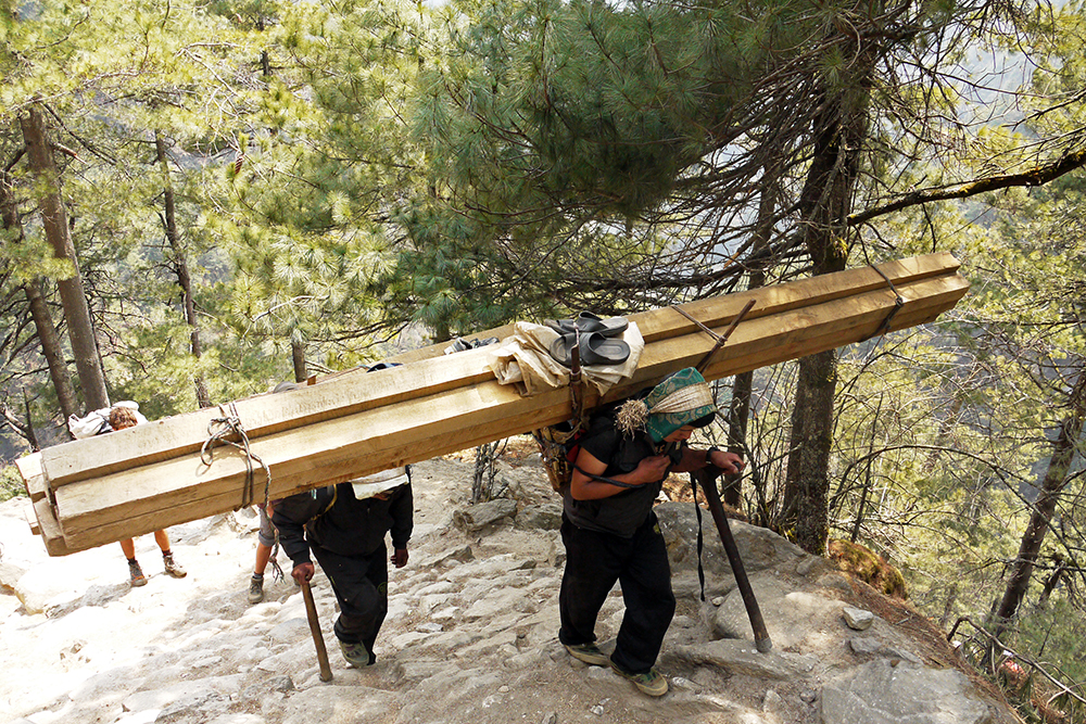 Porters carry impossible loads on the trail