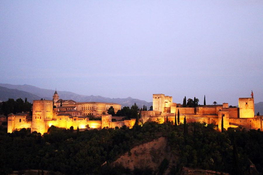 The stunning Alhambra lit up after sunset in Granada