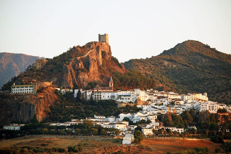 Sunset sasts a glow over Zahara de la Sierra, one of Andalusia's white hill towns