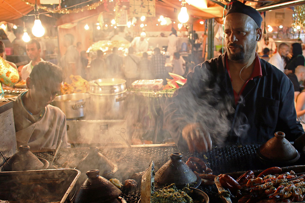 Cooks hard at work in the Jemaa el-Fnaa nightly food market.