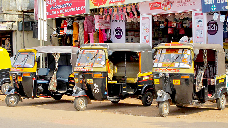 Getting Around - Auto rickshaws wait in line to shuttle passengers around