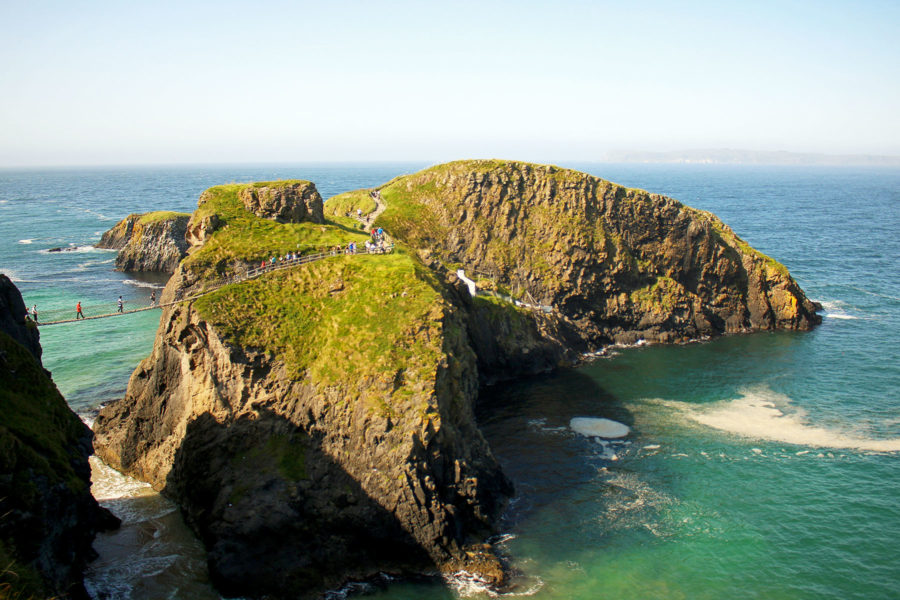 Stunning views of Carrick-a-rede rope bridge leading out to Carrick-a-rede Island on the Giant's Causeway Coastal Route