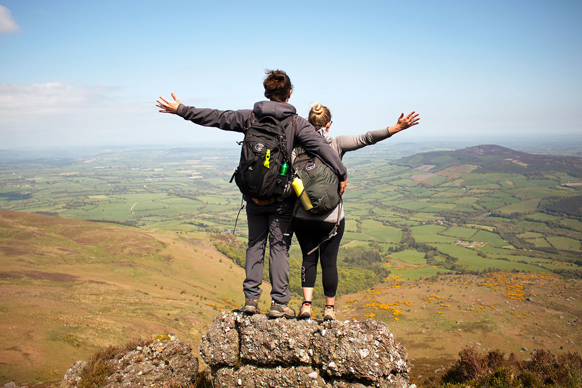 Be Inspired And Go! | Brian and Noelle looking at a view on a hillside in Ireland
