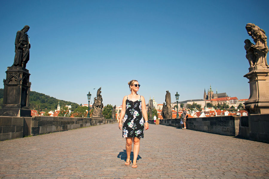 Walking across Charles bridge, one of the best free things to do in Prague, Prague on a budget