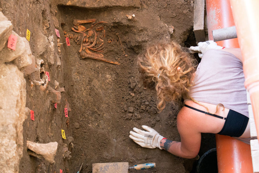 An archaeologist work to excavate more remains under Kutna Hora Bone Church | A day trip from Prague to Kutna Hora Church of bones