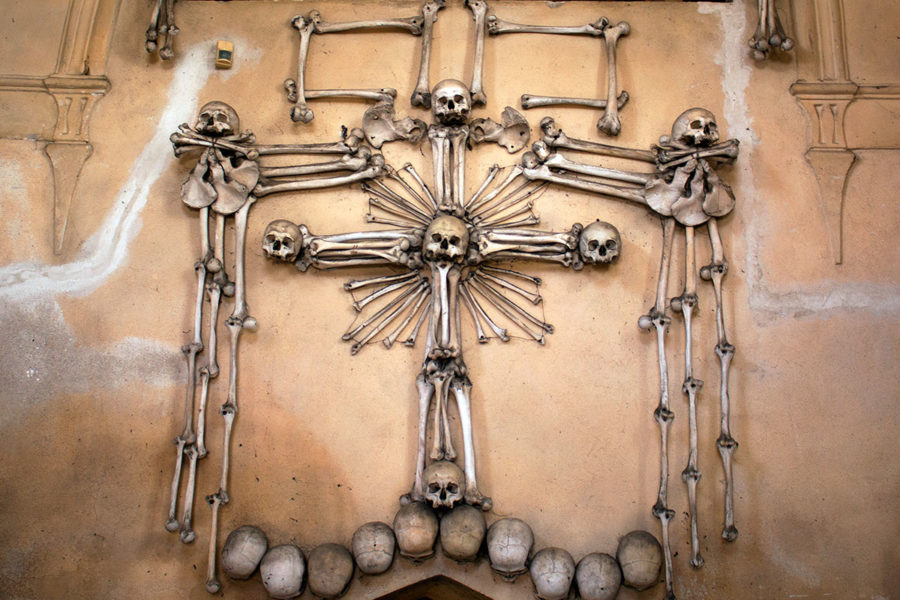 A macabre bone crucifix inside Sedlec Ossuary | A day trip from Prague to Kutna Hora bone church