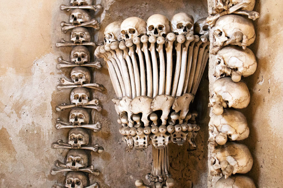 A candelabra made entirely of human skulls and bones! | Kutna Hora bone church