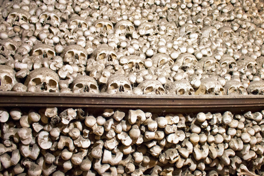 A close-up of one of the huge pyramids of human bones inside Sedlec Ossuary | A day trip from Prague to Kutna Hora bone church