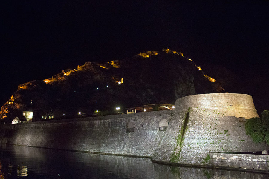 Kotor's old town walls with San Giovanni Fortress lit  up in the background  | things to see in Kotor